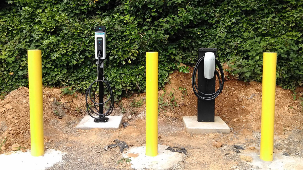 Tesla And Universal Electric Car Charging Station